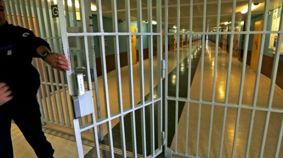 A warder closes the gate inside the men's building at the Fleury-Merogis prison, near Paris,  in this May 14, 2014 file picture. The French investigation into last week's Paris shootings at satirical weekly Charlie Hebdo and a Jewish supermarket is exploring the possible role of Djamel Beghal, an Islamist suspected of first bringing the gunmen together and putting them on the path from impressionable youths to cold-blooded killers. While the 49-year-old Algerian has denied through his lawyer any involvement in the attacks, judicial and prison sources have described how two of the three gunmen nonetheless fell under his spell during a joint 2005 stretch in Fleury-Merogis and then pursued contacts with him after leaving prison.  Picture taken May 14, 2014. REUTERS/Charles Platiau/File (FRANCE - Tags: CRIME LAW CIVIL UNREST)